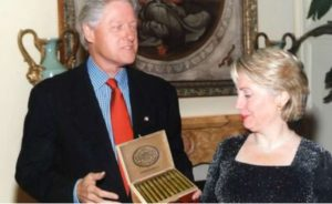 Hillary_Eyes_Bills_Cigars