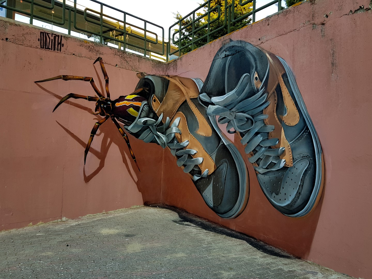 StreetArt_ODEITH_watch-your-shoes-before-you-wear-them